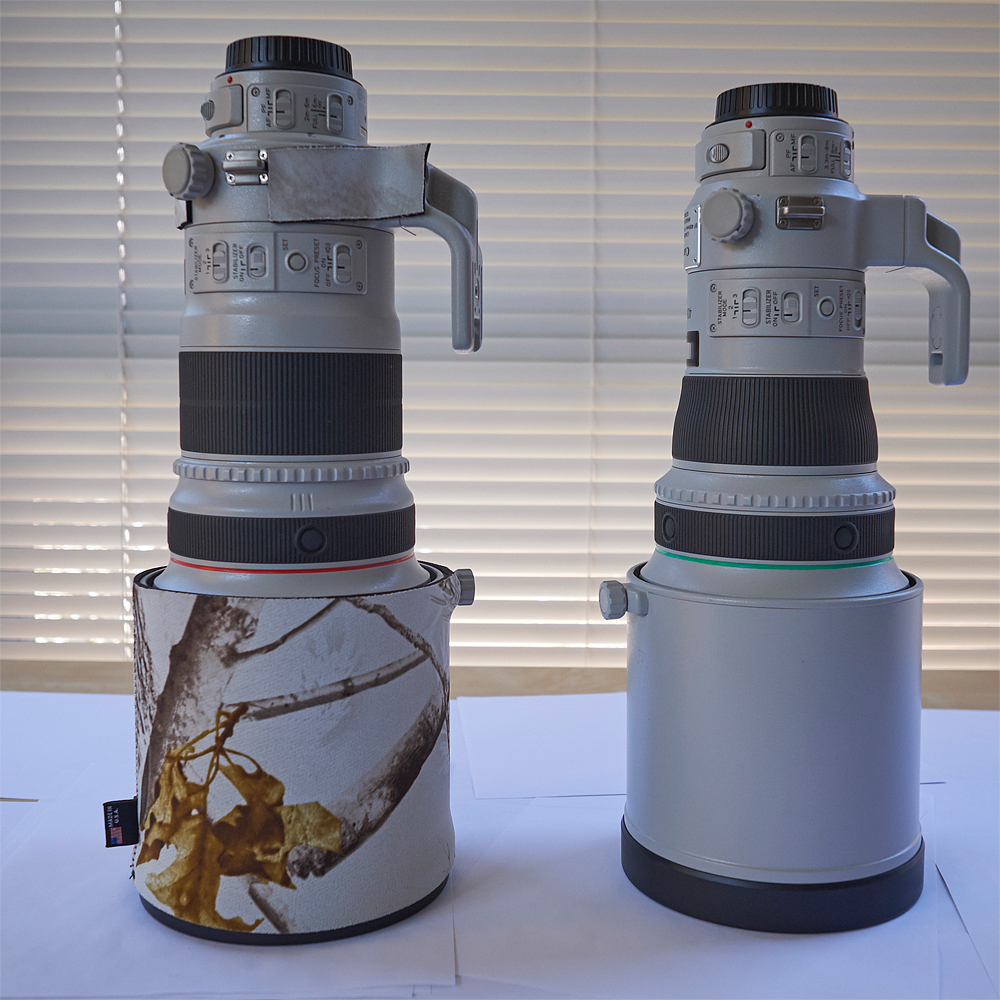 EF 400mm f/4 DO IS II (right) vs. EF 300mm f/2.8 IS II (left) . The DO  is shorter and narrower than the 300. Both lenses share the same lens hood.