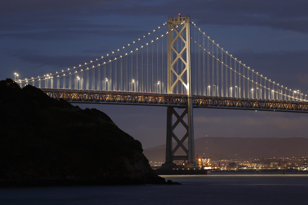 San Francisco Bay Bridge. EOS-1D X Mark II, EF 70-200mm f/2.8 IS II. ISO 100. 5 sec at f/4. On tripod. RAW conversion with DPP 4.4. Same scene was immediately exposed with the EOS-1D X with the same settings.