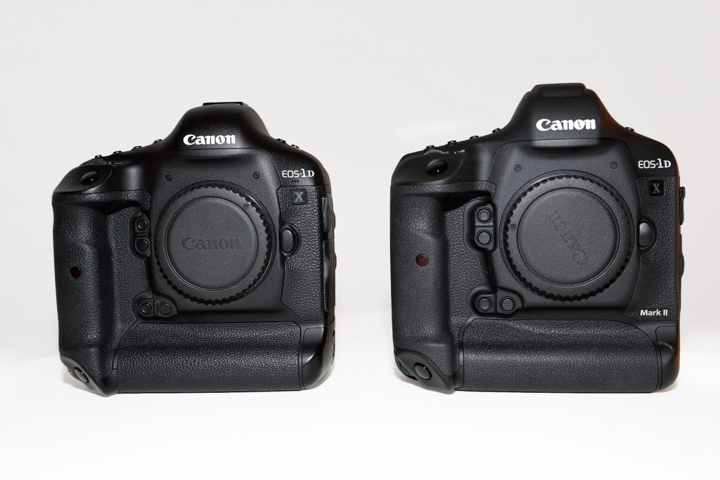 EOS-1D X (left) and EOS-1D X Mark II (right). The cameras look very similar form this angle. Note the small plastic cap on the EOS 1DX Mark II prism housing. The GPS receiver resides here.