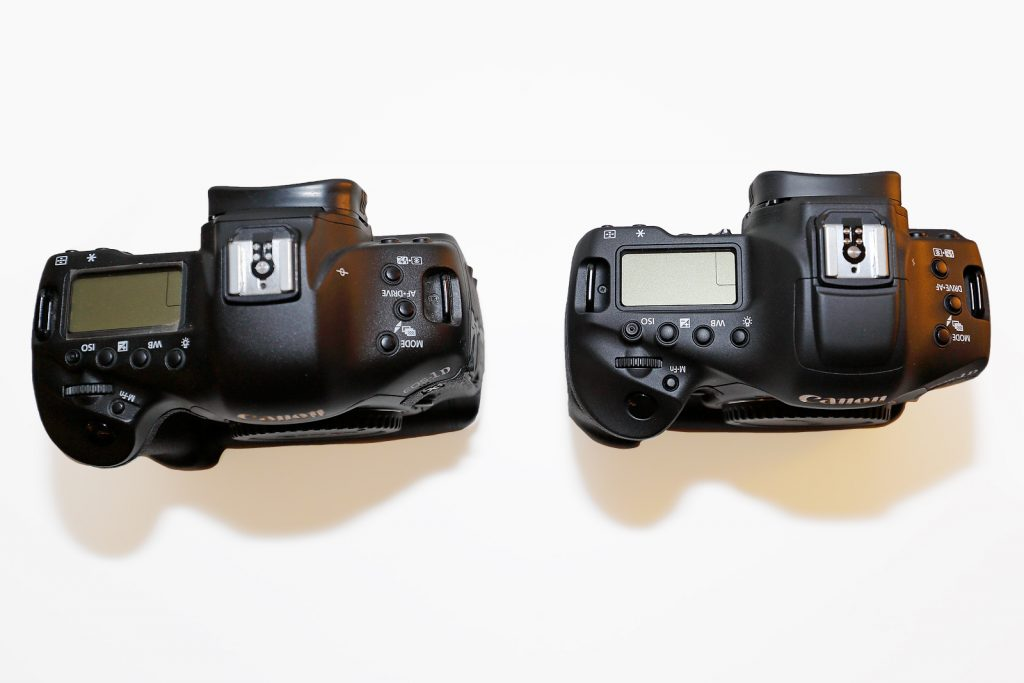 EOS-1D X (left) and EOS-1D X Mark II (right). The top plate and the status LCD is virtually identical between the two bodies.