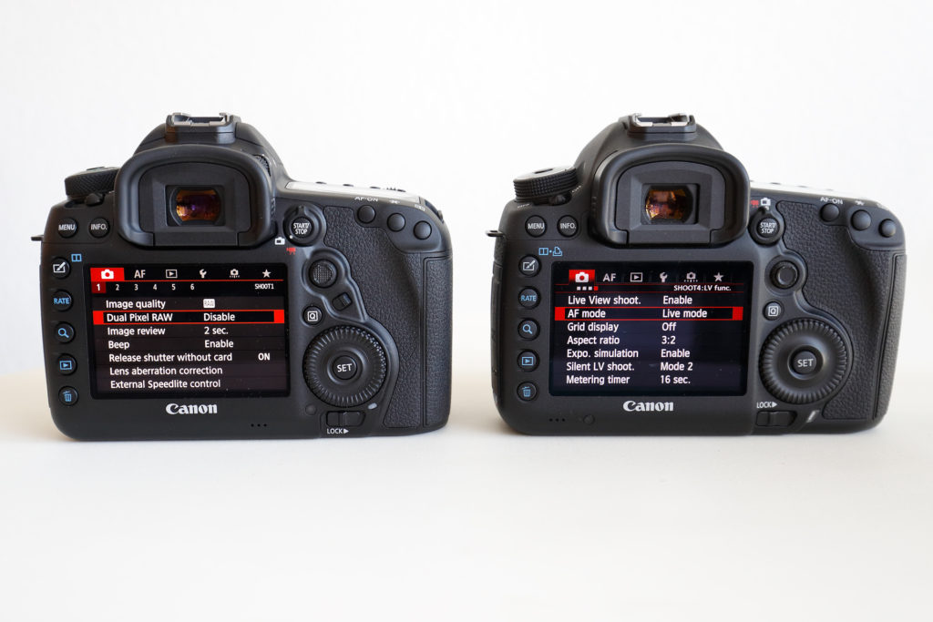 EOS-5 D Mark IV (left) vs. EOS-5D Mark III (right). The rear of the cameras are similar save for the new AF selection button on the EOS-5D Mark IV. This button controls the AF pattern by default but it can be programmed to perform other functions as well.
